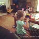 Bella pretending all the playdoh was poop.